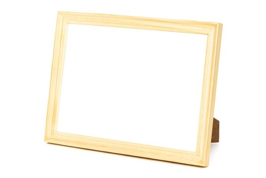 Standing wooden picture frame isolated on white background with clipping path