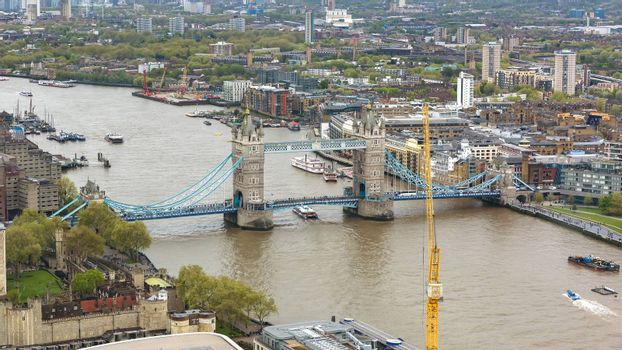 Aerial view of Tower Bridge in London on a cloudy day