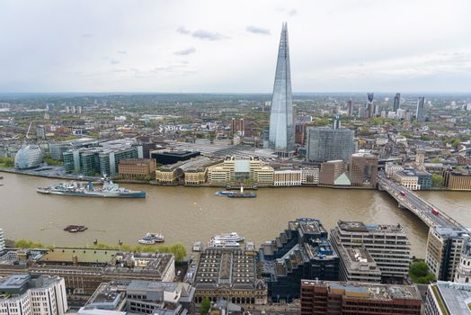 Aerial view of the river Thames in central London on a cloudy day