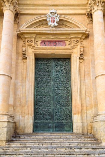 Carved door of Saint Nicholas of Myra Cathedral in Noto