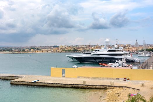 Luxury yachts moored in the port on Ortygia Islands in Syracuse, Sicily, Italy