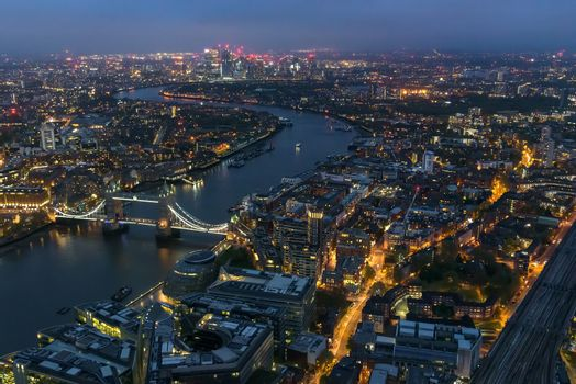Aerial view of river Thames in London on a cloudy night