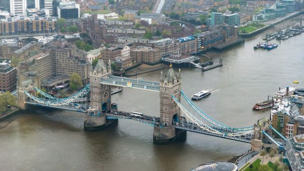 Aerial view of Tower Bridge in London at an overcast day