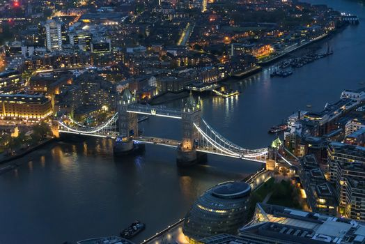 Aerial view of Tower Bridge in London at an overcast day at night