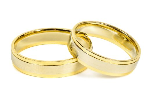 Golden wedding rings isolated on white background with clipping path