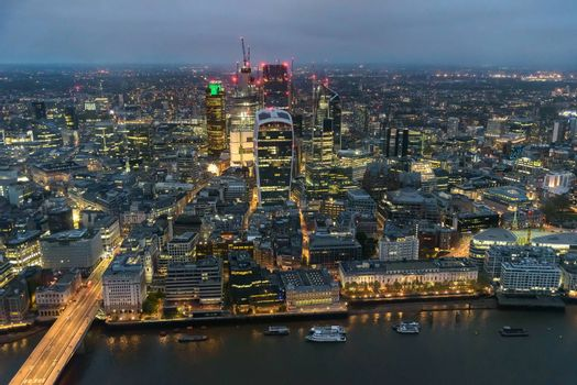 Aerial view of City of London at night on a cloudy day
