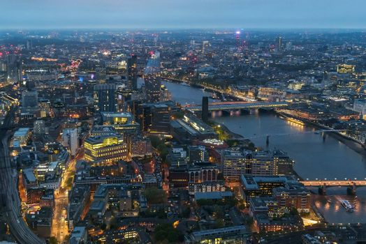 Aerial view of Southwark district in London on a cloudy day at dusk