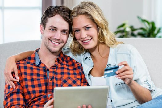 Couple paying with credit card
