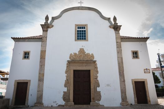 Albufeira, Portugal - May 3, 2018: architectural detail of the Church of Saint Sebastian (Igreja de Sao Sebastiao) in the city center on a spring day
