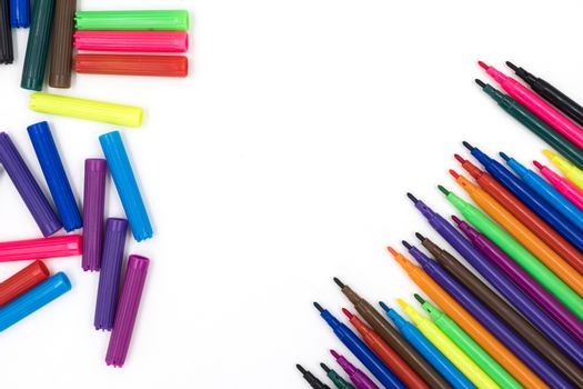 Multi-Color markers pens on white background.