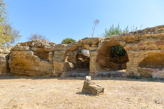 Ancient city wall with Arcosol Tombs in the Valley of the Temples in Agrigento, Sicily, Italy