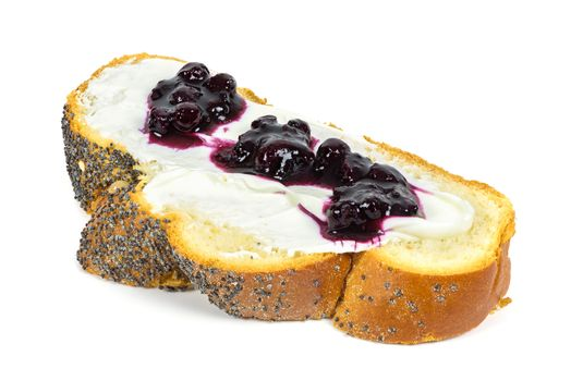 Slice of challah bread with cottage cheese and jam isolated on white background with clipping path