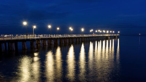 Panoramic view of wooden pier in Gdynia Orlowo in Poland at night