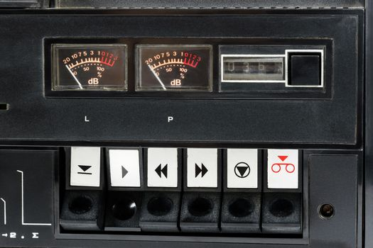 Closeup of control buttons of old audio analog tape recorder