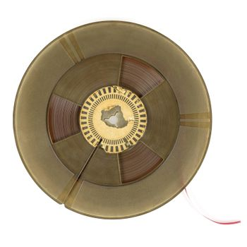 Reel of vintage audio tape isolated on white background with clipping path