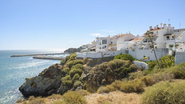 Residential buildings at the Atlantic ocean coast in Albufeira, Algarve, Portugal