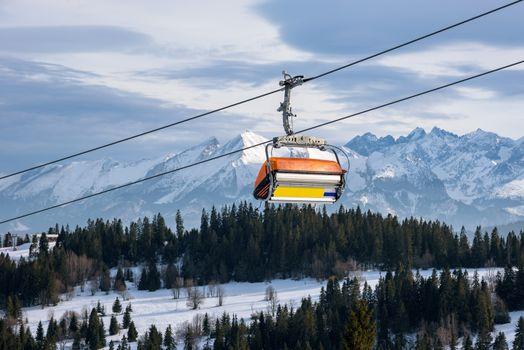 Modern chair lift in ski resort in Tatra Mountains