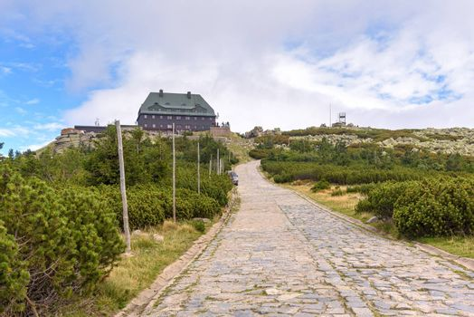 Paved mountain trail to the shelter on the summit of Szrenica mountain in Giant Mountains, Poland