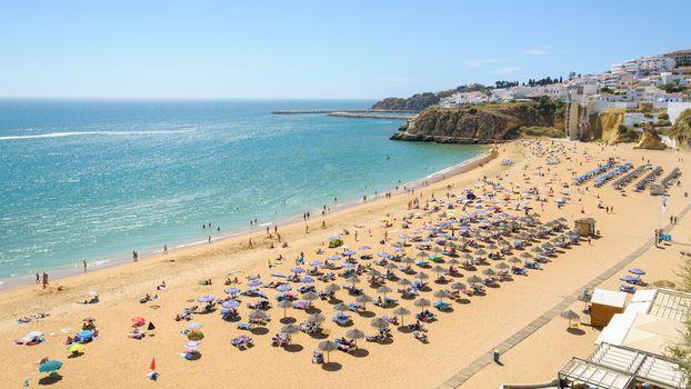 View of sunny public beach in Albufeira, Algarve, Portugal