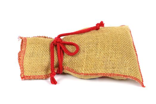 Textile sack with red string isolated on white background