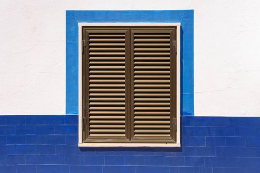 Closed wooden window shutters of an typical mediterranean house