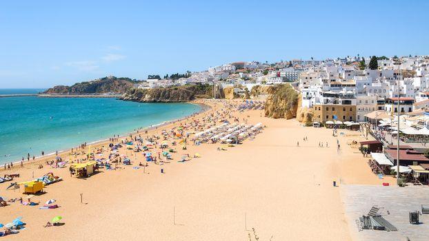 Panoramic view of beach in Albuferia town in summer, Algarve, Polrtugal