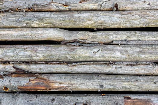 Old wooden wall made of logs as a background