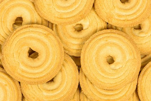 Heap of butter cookies as background