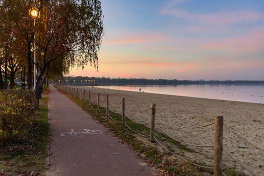 Bicycle path at Pogoria III lake in Dabrowa Gornicza at sunset