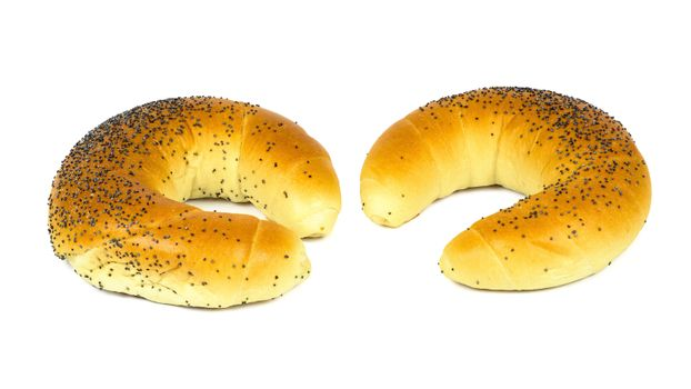 Crescent rolls with poppy seeds isolated on white background with clipping path