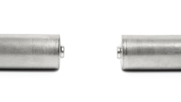 Close up of the positive poles of two batteries isolated on white background with clipping path