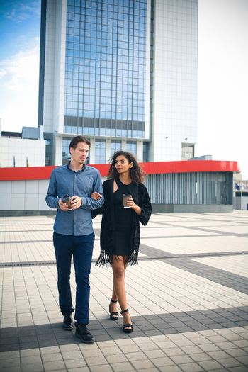 Modern business man and woman wearing smart casual clothes in the city. Urban lifestyle.