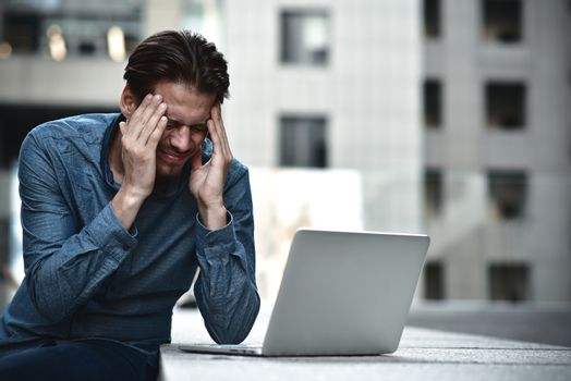 Stressed businessman after project failure. Confused young man frustrated by online problem.