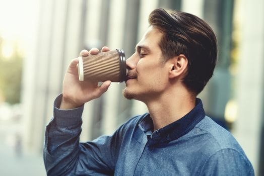 Men drinking coffee.Close-up of men drinking coffee outdoors