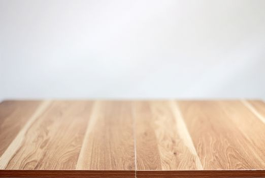 Brown empty wooden table top with wall background