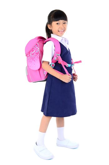 Portrait of Asian child in school uniform with school bag on white background isolated.