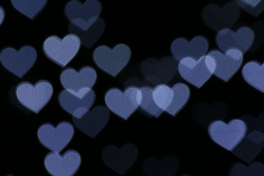 Colorful heart-shaped on black background lighting bokeh for decoration at night backdrop wallpaper blurred valentine, Love Pictures background, Lighting heart shaped soft at night abstract