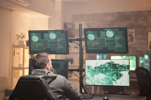Dangerous hacker writing a malware to hack a network