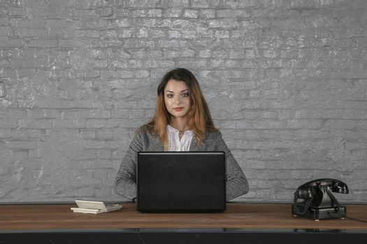 young business woman sitting at her own desk