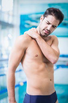 Handsome man with shoulder ache