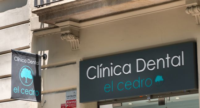 Barcelona, Spain - June 21, 2017: facade of the El Cedro dental clinic in the city center on a summer day