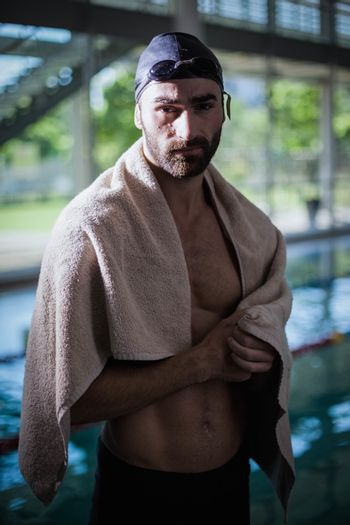 Serious man drying himself with a towel