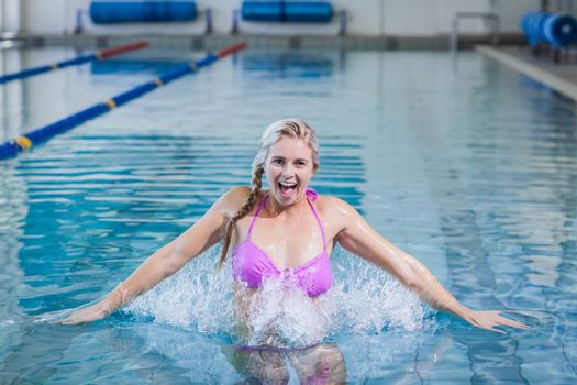 Pretty woman doing aqua aerobics