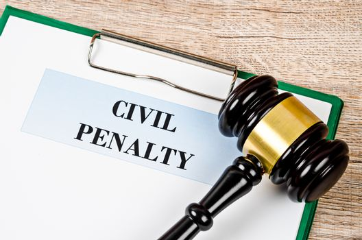 Civil penalty and gavel with document.