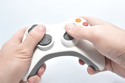joystick gamepad in the player's hands isolated on white background