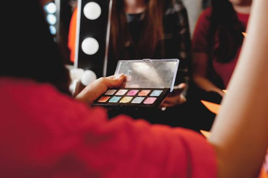 makeup. The process of applying makeup will begin. Colorful palette. Cosmetics for festive evening day makeup