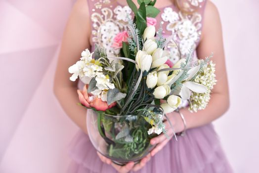 little girl with artificial flowers, close-up view