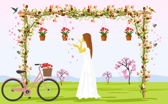 Women in white skirts are watching the flowers on the wooden pergola . There is a bike parked beside With grasslands and trees as background