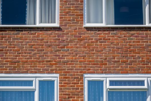 Shapes and pattern of four windows in a block of flats