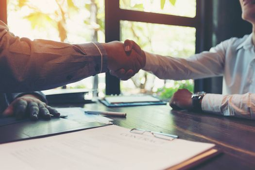 Business people shaking hands, Businessmen negotiate a serious i